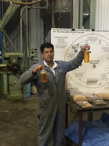 Facility Manager Nebayot Chalma explaining the crushing process to an AgForestry group.